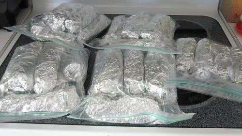 Finished vegan bean burritos, wrapped in foil and then stored in a plastic bag will keep for 3 months in the freezer.