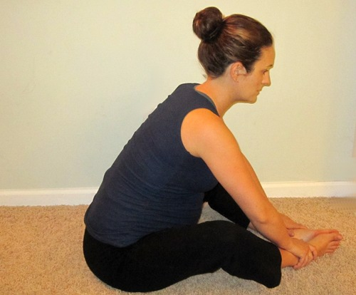 Putting your legs into a diamond shape during prenatal yoga helps alleviate back pain.