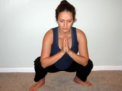 Front view of squatting during prenatal yoga.